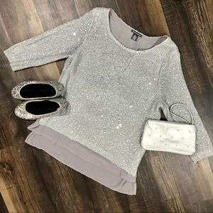 Chelsea and Theodore silver sparkly sweater